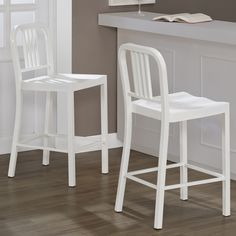 Add some extra seating to your kitchen with these classic metal counter stools. This set of two white stools feature a durable powder coat finish, which will stand-up to mars and scratches. For added comfort, these stools have a contoured seat.