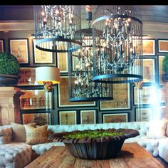 Loving the wall art and amazing birdcage chandeliers from Restoration Hardware.