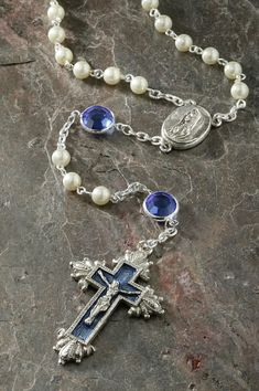"""Sapphire enameled cross and ½"""" Sapphire Swarovski® crystals combined with pearls make this a treasured gift for just about anyone also ideal for September birthdays. Let this rosary help you meditate"""