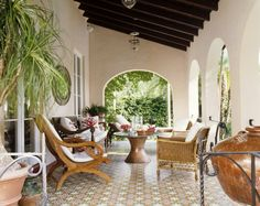 Love the dark wood ceilings and the tiled floor - this is what I envision in our yard, but with more comfy seating.