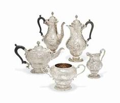 A LATE VICTORIAN/EDWARDIAN FIVE-PIECE SILVER TEA AND COFFEE SERVICE OF EARLY GEORGE III STYLE MARK OF GEORGE LAMBERT, LONDON, 1900/01