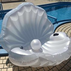Mermaid Clam Pool Float Pre-Order Only. Release your inner mermaid queen with this flawless pool throne to elevate your summer. Our transparent and pearl merma