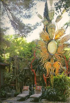 """Duquette created this sculpture: the 28 ft tall """"Phoenix Rising From His Flames"""""""