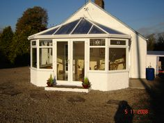 White PVCu DIY Stretched-Victorian Conservatory. Manufactured and supplied by ConservatoryLand DIY Conservatories. Photo kindly supplied by our customer.