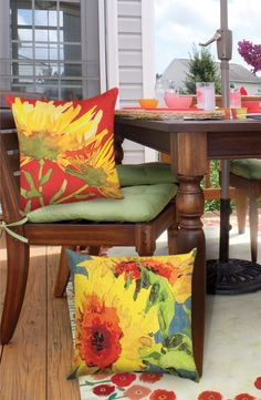 Dress up your outdoor living area with weather resistant throw pillows. Instantly add a pop of color, style and comfort to your patio or deck. #patiodecoratingideas #patiodecorating #oudoorliving #outdoorpillows