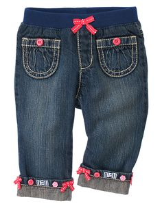 Buttons and bows on super cute denim! Our stylish jean features a permanent roll-up cuff brightened up with multicolor bows and buttons. Comfy pull-on denim design is finished with a ribbed waist accented with a grosgrain ribbon bow. 100% cotton denim. Easy pull-on style. Front and back pockets. Full length. Machine washable. Imported. Collection Name: Blooming Nautical.