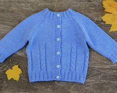 Pale blue sweater baby boy sweater newborn boy sweater kids wool sweater knit wool cardigan sweater boy easter outfit light blue cardigan - Knitting - Wonderful raglan sweater with arans for your kids knitted from a wool yarn, soft and warm. Your chi - Cardigan Bleu, Baby Boy Cardigan, Baby Girl Cardigans, Knit Baby Sweaters, Boys Sweaters, Wool Cardigan, Knitting For Kids, Baby Knitting, Crochet Baby