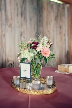 Tiger Lily Weddings - I like the gold tray and candles.
