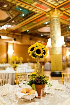 Potted sunflower centerpieces | Art Pop Modern New York City Wedding In Shades Of Yellow | Photograph by Cassi Claire  http://storyboardwedding.com/art-pop-modern-new-york-city-wedding-shades-yellow/