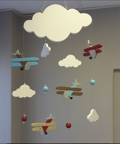 For boys with an adventurous heart, our Wooden Plane Mobile is made to keep the imagination flying; perfect for any boys airplane theme nursery! Nursery Themes, Nursery Room, Wooden Plane, Nursing Chair, Baby Boy Rooms, Nursery Furniture, Travel Themes, Bedding Collections, Kids Room