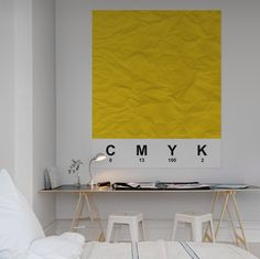 White Bed & Workplace, with large yellow square poster