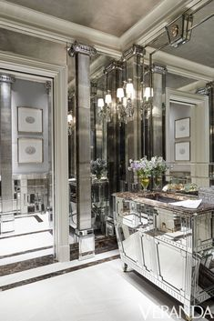 Luxury design with mirror decor in a bathroom. Antic columns and lighting, marble benchtop - everything speaks about chic and elegance. However, excess of glass surfaces sometimes can create the sense of coolness in the area. Home Interior, Bathroom Interior, Interior Decorating, Interior Design, Decorating Ideas, Decor Ideas, Design Bathroom, Bathroom Furniture, Mirrored Furniture