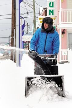 Adrian Bagrin with the Sea n' Sun Motel in Wildwood uses a snow blower to clean up the block around the motel after a passing storm left several inches in Cape May County Tuesday, Feb. 17.