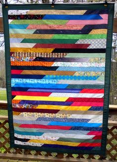 Jelly Roll Quilt by seasew2mch of the quiltingboard.com