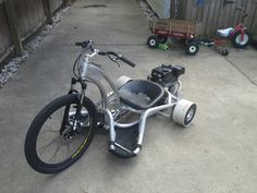 custom motorized aluminum drift trike... what's that in the background?