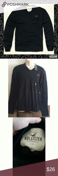 Navy Blue Hollister V Neck Sweater Light comfortable material. Would make a wonderful Valentine's day gift. New with tags. Size xl. Navy blue in color with red Hollister Bird in on chest area . 53% cotton 40% viscose, 7% nylon. Hollister Sweaters V-Neck