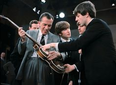 9th February 1964. Paul lets Ed Sullivan play his Hofner bass during rehearsals for The Beatles first appearance on his show.