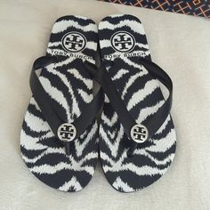 Rare Tory Burch Zebra Flip Flops Rare and hard to find Tory Burch zebra print flip flops! Dark navy but look black with silver TB logos. Size 5. Perfect! Get them for summer which will be here before you know it! Fast shipping on all my items!! I accept reasonable offers!! Tory Burch Shoes Sandals