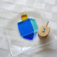 Fused Glass Hanukkah  Plate, Hanukkah Decor, Colorful Dreidel in Blue and Turquoise, Sevivon, Spinning Top, Judaica Glass Gift by Shakufdesign on Etsy https://www.etsy.com/listing/218664874/fused-glass-hanukkah-plate-hanukkah