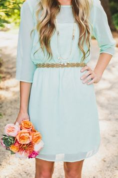 This bright bouquet pops against the soft aqua dress.