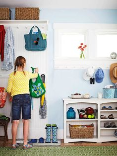 "Mudroom...love the bookcase for shoes, and the tray lined with pebbles.  I bet a cookie sheet would be cheaper and work as well as the 22 dollar ""boot tray"" from Crate & Barrel."