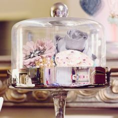 Display your most beautiful accessories on a covered cake stand or under a cloche
