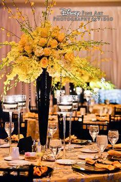 Bright yellow floral centerpiece at a Walt Disney World wedding reception