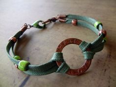 Rita etched a copper washer to create the center link on this bracelet, and used a clasp and beads from C-Koop to add more color.