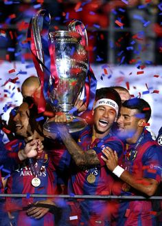 Neymar of Barcelona lifts the trophy as he celebrates victory with team mates after the UEFA Champions League Final between Juventus and FC Barcelona at Olympiastadion on June 6, 2015 in Berlin, Germany.