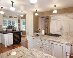 White Kitchen Counter white kitchen, shaker cabinets, hardwood floor, black pulls | for