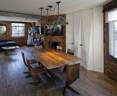 Hard angles, brick walls, beautful worn wood. Lovin' this industrial apartment by  Michaelis Bo...