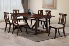 "Angel – Transitional 5 Pcs Walnut Dining Set  This set features a unique walnut look with a stylish side chair that will compliment any dining room. The table is made of solid wood with birch wood veneer and the chairs are upholstered in taupe fabric. This transitional dining table is 84""L and can fit up to 6 chairs. It is an ideal dining set for your family and friends to come over for dinner and special gatherings."