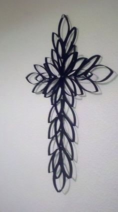 """""""Toilet paper/paper towel rolls, hot glue, black spray paint, silver gemstones. Toilet paper rolls flattened, cut to 1/4"""" wide. There is a second layer on top of the back layer."""""""