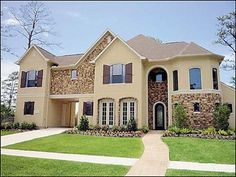 Stone Front Homes white windows- white stucco- mediterranean | exterior color
