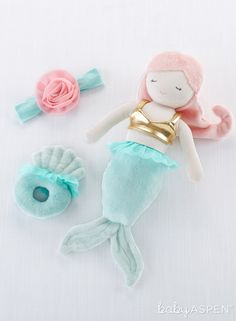 This adorable gift is just mer-made for your little one! Mia is a plush mermaid toy that holds two darling treats for baby - a flower accented baby headband and a seashell baby rattle. It's the greatest gift around, under the sea or not! | Mia the Mermaid Plush Plus Headband and Rattle for Baby | Baby Aspen | #plush #babygifts Mermaid Toys, Mermaid Gifts, Baby Mermaid, Newborn Toys, Baby Girl Newborn, Baby Toys, Baby Baby, Baby Girls, Baby Girl Headbands