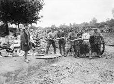 Gunners of the Royal Field Artillery loading 18-pounder shells into limbers. Acheux, Somme, July 1916., Brooks E (Lt)