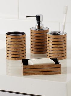 BATHROOM ACCESSORIES Exclusively from Simons Maison Lightweight, shiny black plastic bathroom accessories adorned with a contrasting print of delicate faux-wood stripes for a naturalistic, Scandinavian-inspired design.