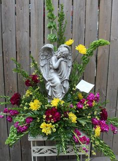 Fresh flower arrangement around an angel. Been wanting to do this for the cemetary, only with artificial flowers Casket Flowers, Grave Flowers, Cemetery Flowers, Church Flowers, Funeral Flowers, Silk Flowers, Arrangements Funéraires, Funeral Floral Arrangements, Funeral Gifts