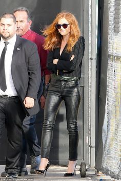 Lookin' good! Isla Fisher sizzled in a pair of sexy leather trousers and stilettos as she ...