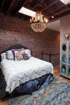 Industrial and elegant mix in this cozy bedroom with exposed brick walls