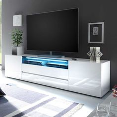TV Board in Hochglanz Weiß LED Beleuchtung Jetzt bestellen unter: https://moebel.ladendirekt.de/wohnzimmer/tv-hifi-moebel/tv-lowboards/?uid=f4fa25f1-af1e-5235-953a-ec6ac31f82d4&utm_source=pinterest&utm_medium=pin&utm_campaign=boards #fernsehboard #rack #phonoschrank #tvboard #fernsehunterschrank #tische #tvhifimoebel #lowboard #schrank #fernsehtisch #unterschrank #möbel #phonomöbel #bank #fernseher #tvtische #sideboard #tvlowboards #fernsehschrank #wohnzimmer #kommode #board