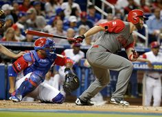 Canada's Rene Tosoni, right, follows through on a single during the second inning as Dominican Republic catcher Welington Castillo (35) looks on in a first-round game of the World Baseball Classic, Thursday, March 9, 2017, in Miami.