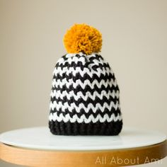 Black & White Zigzag Beanie- striking colour combo with a colourful pom pom!  Free pattern via Kat Goldin