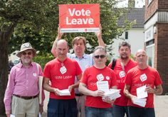 STONEHOUSE, ENGLAND - JUNE 08: Vote Leave supporters pose for a photograph as they campaign on a residential housing estate in Stonehouse on June 8, 2016 in Gloucestershire, England. Britain will go to the polls in a referendum on the 23rd of June to decide whether or not to leave the European Union. (Photo by Matt Cardy/Getty Images)