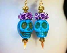 SALE Dia De Los Muertos. Royalty Sugar skull earrings in howlite turquoise. multi colored earrings with flowers and beads.