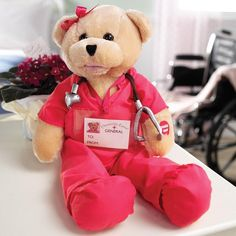 "19"" Pink Scrubs bear. Head sways & mouth moves while singing, ""I'll Be There"". Oh so Lovely and Cuddly Teddy Bear! This 19 Teddy Bear is dressed in a beaut"