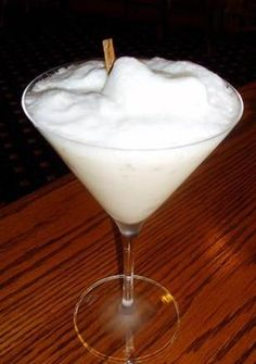 The Snowball - Grey Goose Vodka, Kahlua and heavy cream are combined in a shaker and strained over crushed ice into a martini glass. Topped with a scoop of foamed milk and garnished with a cinnamon stick