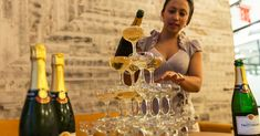 Serving Champagne from a Champagne Tower is a very impressive party trick. Learn how easy it is to build a Champagne Tower with our step-by-step guide!