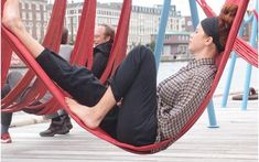 The hammocks, made from old fire hoses, also double as playground swings. #streetfurniture