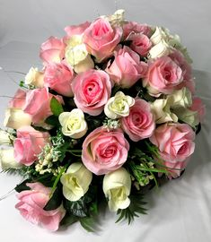 Simple wedding flowers info getting a bridal dress can be expensive spring rose centerpiece white rose decor rose wedding decor rose saddle rose mightylinksfo